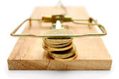Coins in mousetrap. On a white background. — Stock Photo