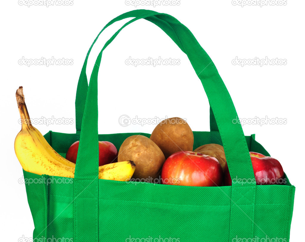 Reusable Green Bag with Groceries Isolated on White — Stock Photo #10592927