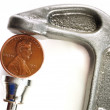 Pinching a Penny in a C Clamp — Stock Photo