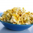 Bowl of popcorn against white background — Stock Photo