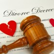 Stock Photo: Broken red hearts and legal gavel on divorce papers