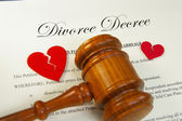 Broken red hearts and legal gavel on divorce papers — Stock Photo