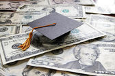 Graduation cap on cash — Stock Photo