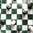 Shot from above of chess pieces and board — Stock Photo