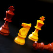 Stock Photo: Group of chess pawns on the board, one in the lead
