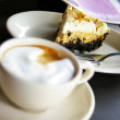 Frothy coffee and cake — Stock Photo