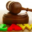 Court gavel with colored play law letters — Stock Photo #9320457