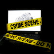 Computer with crime scene tape — Stock Photo