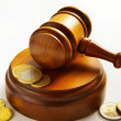 Assorted euro coins and judges court gavel — Stock Photo