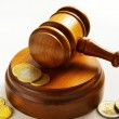 Stock Photo: Assorted euro coins and judges court gavel