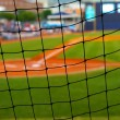 Baseball field, shot from behind the net at home plate — Stock Photo