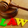 "Stock Photo: Court gavel and play letters spelling ""law"""