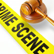Gavel and yellow crime scene tape - Stock Photo