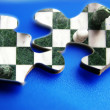 Closeup of two puzzle pieces with chess image - Stock Photo