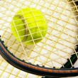 Stok fotoğraf: Tennis racket strings and tennis ball, closeup