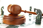 Chess pieces and law gavel — Stock Photo