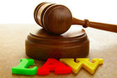 Court gavel with colored play law letters — Stock Photo