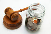 Gavel and coin jar — Stock Photo
