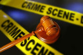 Gavel and police crime scene tape — Stock Photo