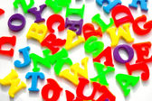 Children's colorful plastic letters — Stock Photo