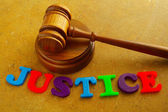 "Court gavel with play letters spelling ""justice"" — Stock Photo"