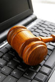 Gavel on a computer — Stock Photo