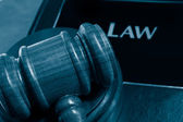 Law book and judges gavel — Stock Photo