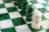 Chess pawns in a line on the board — Stock Photo