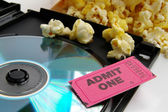 Ticket stub and popcorn with DVD closeup — Stock Photo