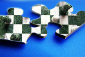 Closeup of two puzzle pieces with chess image — Stock Photo