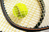 Tennis racket strings and tennis ball, closeup — Stock Photo