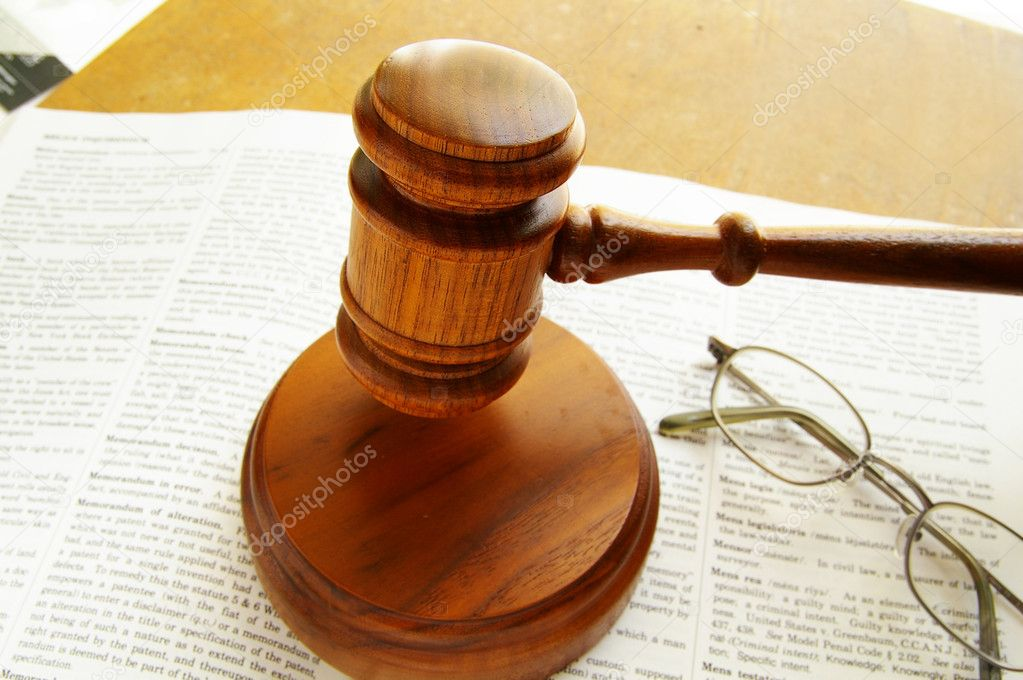 Judges court gavel being pounded, on a law book — Stock Photo #9322928