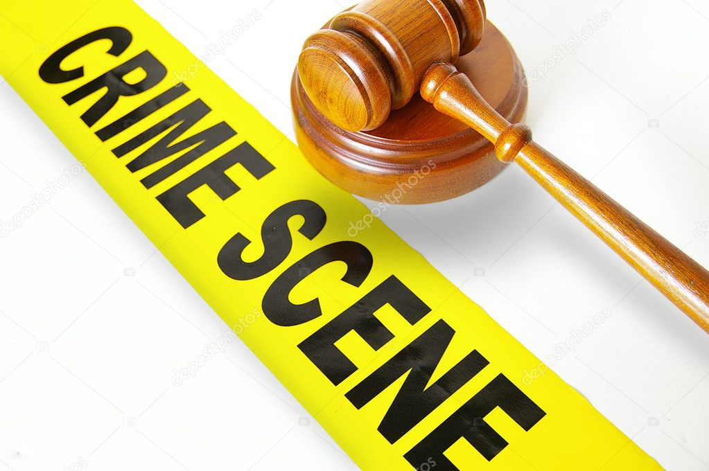 Judges gavel and yellow crime scene tape — Stock Photo #9322938