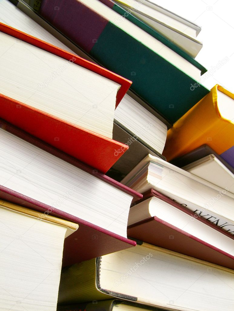 Various hardcover books stacked next to each other — Stock Photo #9327667