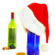 Wine bottles and santa hat - holiday party concept — Stock Photo