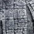 Mayan hieroglyphics carved in stone — Stock Photo