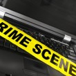 Laptop with crime scene tape — Stock Photo