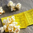 Pair of ticket stubs with popcorn snack — Stock Photo #9339204