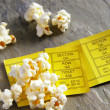 Pair of ticket stubs with popcorn snack — Stock Photo