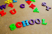 "Children's colorful plastic letters spelling out ""school"" — Stock Photo"