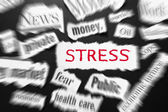 Newspaper headlines showing bad news, stress in red — Stock Photo