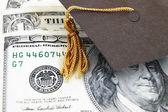 Graduation cap on money — Stock Photo