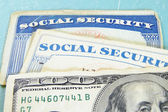 Money and Social Security cards — Stock Photo