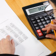 Stock Photo: Analyzing financial data