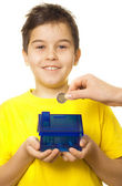 Boy with coin bank — Stock Photo