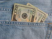 USD notes in blue jeans pocket — 图库照片