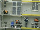 Masons on a scaffolding — Stock Photo