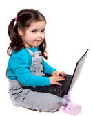 Child with a laptop — Stock Photo