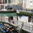 Venetian gondola boats & bridge — Stock Photo