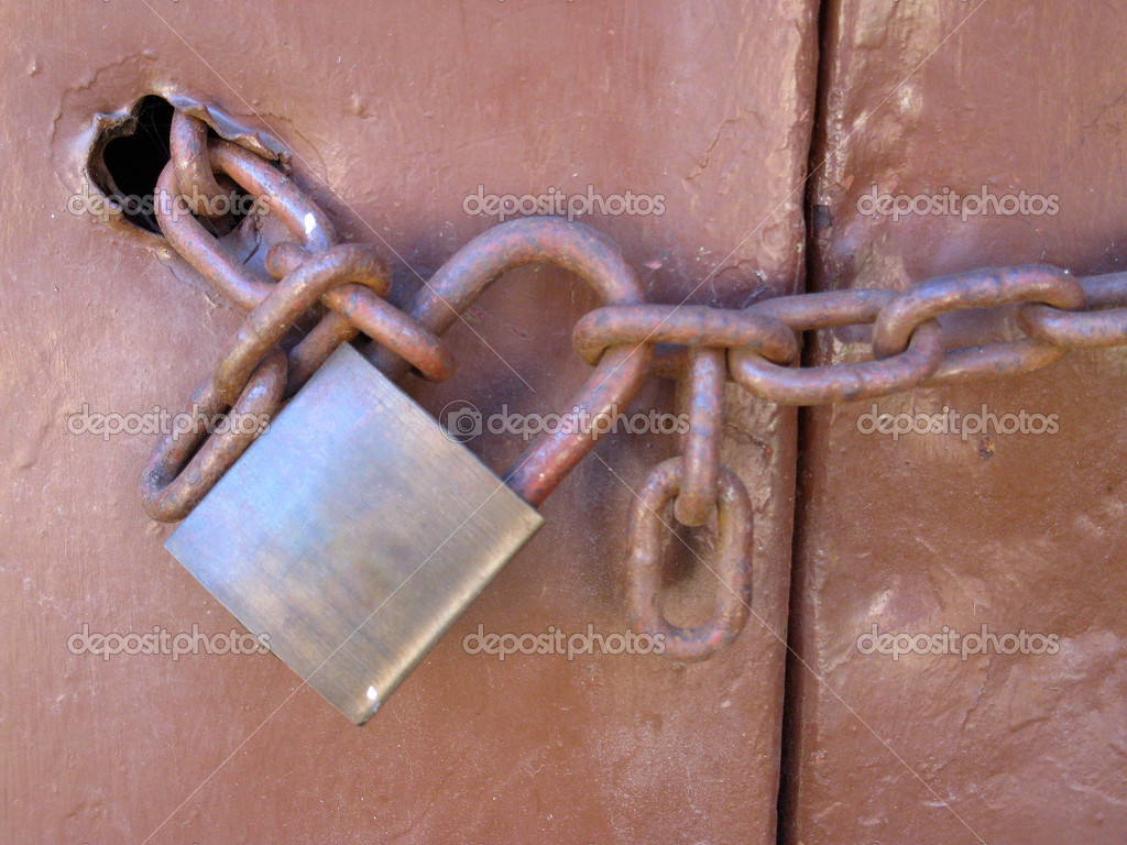 Padlock and chain from metal door — Stock Photo #10421621